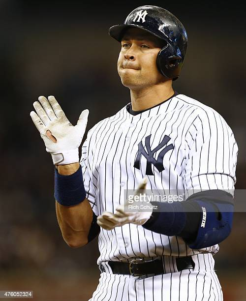 Alex Rodriguez of the New York Yankees claps after hitting an RBI single in the fifth inning against the Los Angeles Angels of Anaheim during a MLB...