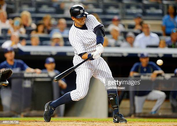 Alex Rodriguez of the New York Yankees connects on a second inning two run home run against the Tampa Bay Rays at Yankee Stadium on September 4 2015...