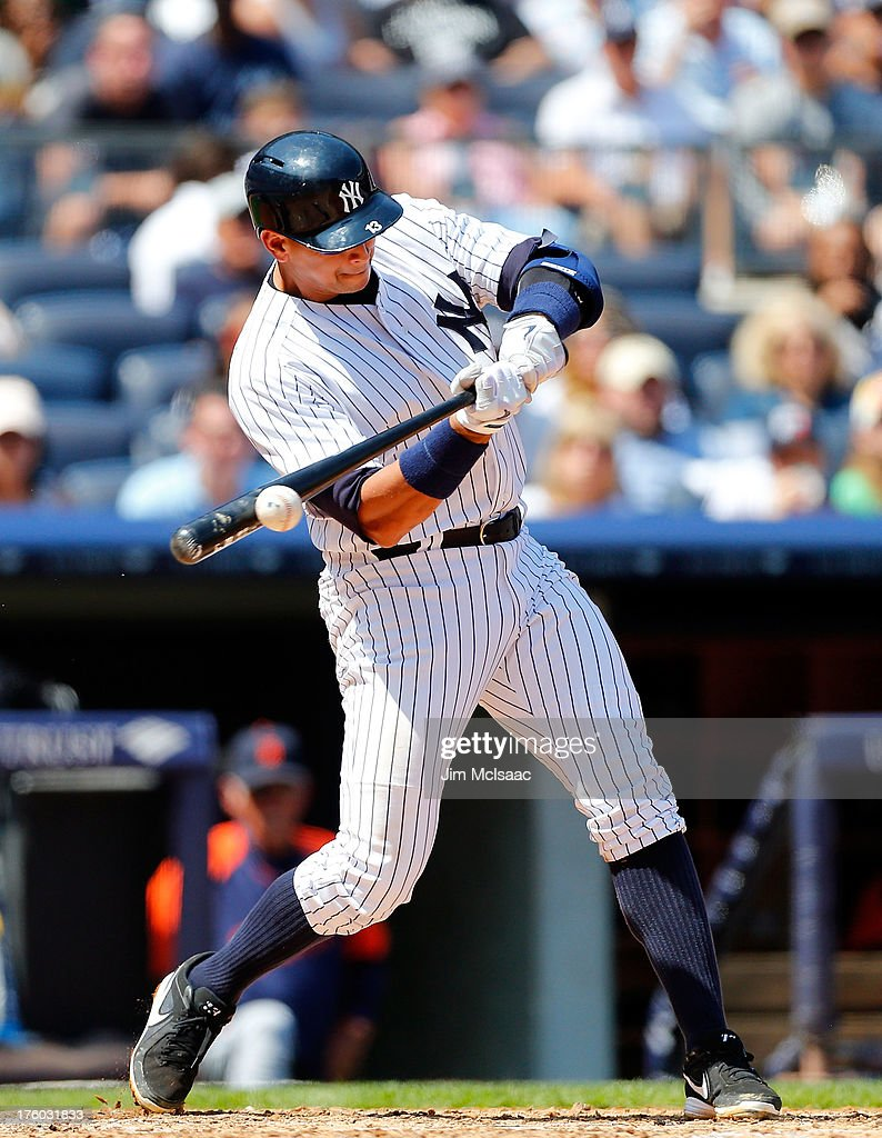 Alex Rodriguez #13 of the New York Yankees connects on a third inning RBI base hit against the Detroit Tigers at Yankee Stadium on August 11, 2013 in the Bronx borough of New York City.