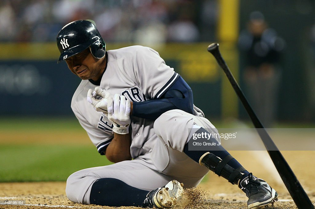 Alex Rodriguez #13 of the New York Yankees crumples to the ground after being hit with a pitch by starting pitcher Felix Hernandez of the Seattle Mariners at Safeco Field on July 24, 2012 in Seattle, Washington. Rodriguez was removed from the game.