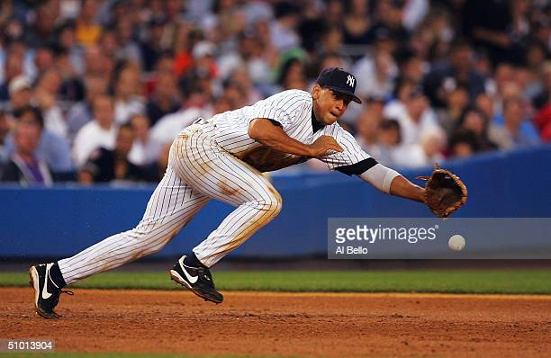 Alex Rodriguez of the New York Yankees dives after a ball hit by Doug Mirabelli of the Boston Red Sox June 30 2004 at Yankee Stadium in the Bronx New...