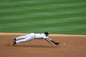 Alex Rodriguez of the New York Yankees diving for the baseball during the game against the Cleveland Indians at Yankee Stadium in the Bronx New York...