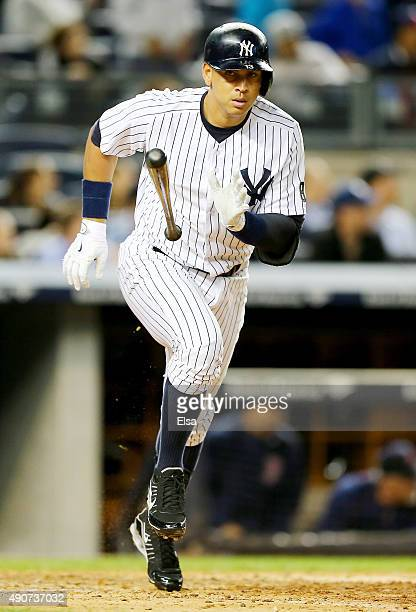 Alex Rodriguez of the New York Yankees drops his bat after he hit a solo home run in the sixth inning against the Boston Red Sox on September 30 2015...