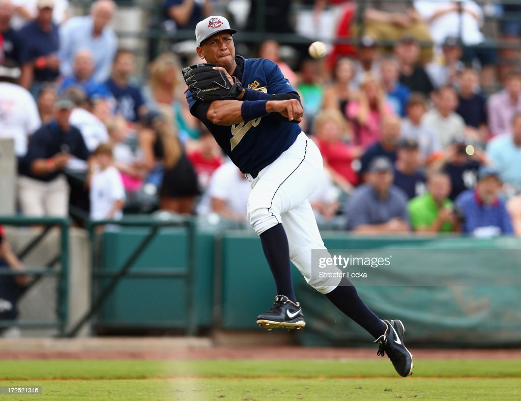 Alex Rodriguez of the New York Yankees fields a ball during his game for the Charleston RiverDogs at Joseph P. Riley Jr. Park on July 2, 2013 in Charleston, South Carolina.