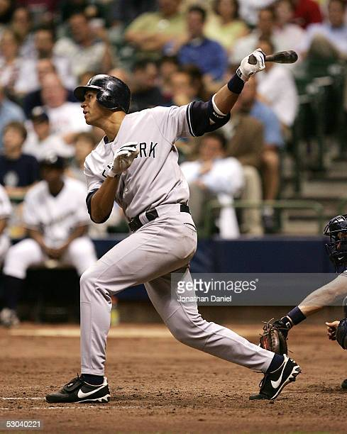 Alex Rodriguez of the New York Yankees follows the flight of his 400th career home run a solo shot in the eighth inning against the Milwaukee Brewers...