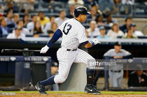 Alex Rodriguez of the New York Yankees follows through on a fifth inning single to left field his 2999th career hit against the Miami Marlins at...