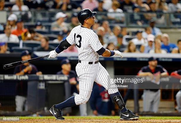 Alex Rodriguez of the New York Yankees follows through on a fourth inning home run against the Cleveland Indians at Yankee Stadium on August 20 2015...