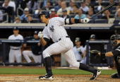 Alex Rodriguez of the New York Yankees follows through on his first inning RBI double against the Chicago White Sox on April 30 2010 at Yankee...