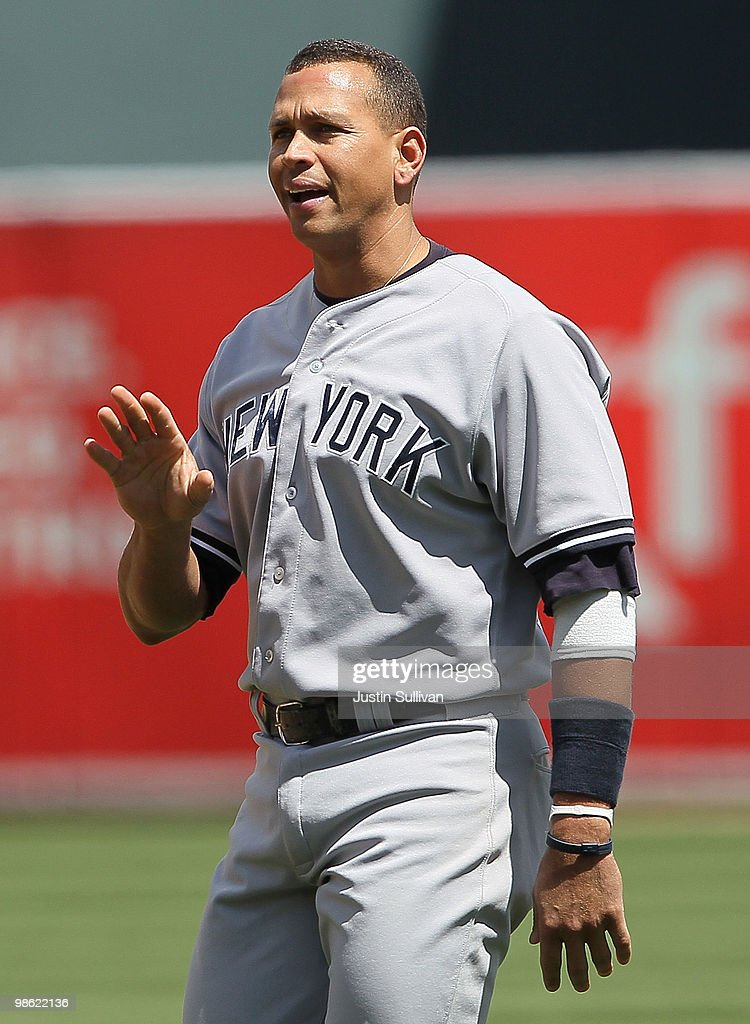 Alex Rodriguez of the New York Yankees gestures towards the Oakland Athletics dugout during a verbal altercation with pitcher Dallas Braden of the...
