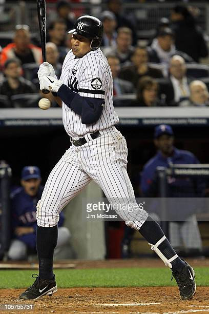 Alex Rodriguez of the New York Yankees gets hit by a pitch against the Texas Rangers in Game Four of the ALCS during the 2010 MLB Playoffs at Yankee...