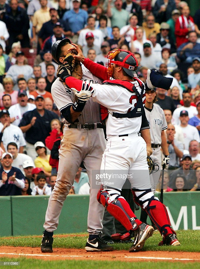 Alex Rodriguez of the New York Yankees gets into a fight with catcher Jason Varitek of the Boston Red Sox after Rodriguez was hit by a pitch in the...
