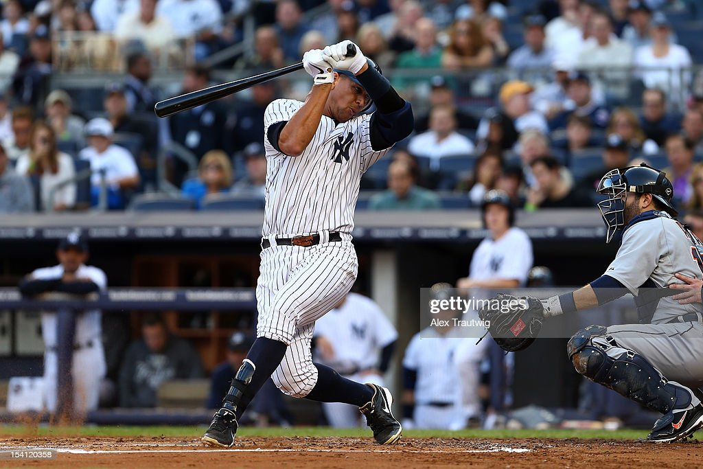 Alex Rodriguez #13 of the New York Yankees gets twisted up on a swing during an at bat in th esecond inning against the Detroit Tigers during Game Two of the American League Championship Series at Yankee Stadium on October 14, 2012 in the Bronx borough of New York City.