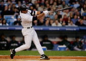 Alex Rodriguez of the New York Yankees hits a home run in the second inning against the Tampa Bay Devil Rays during their game April 18 2005 at...