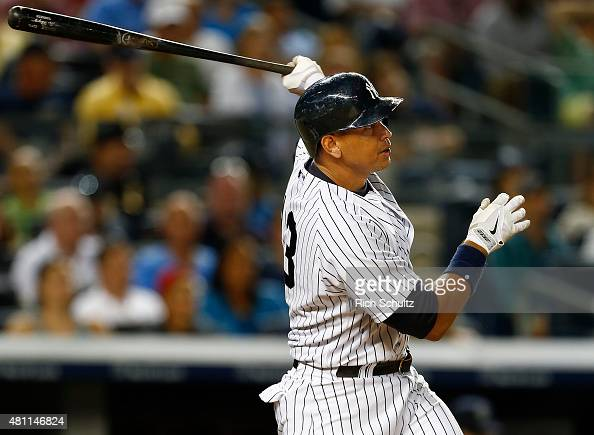 Alex Rodriguez of the New York Yankees hits a home run in the seventh inning against the Seattle Mariners during a MLB baseball game at Yankee...