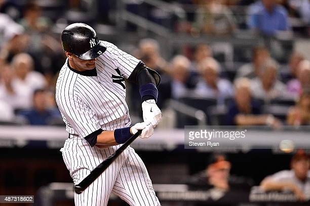 Alex Rodriguez of the New York Yankees hits a home run in the sixth inning against the Baltimore Orioles at Yankee Stadium on September 8 2015 in New...