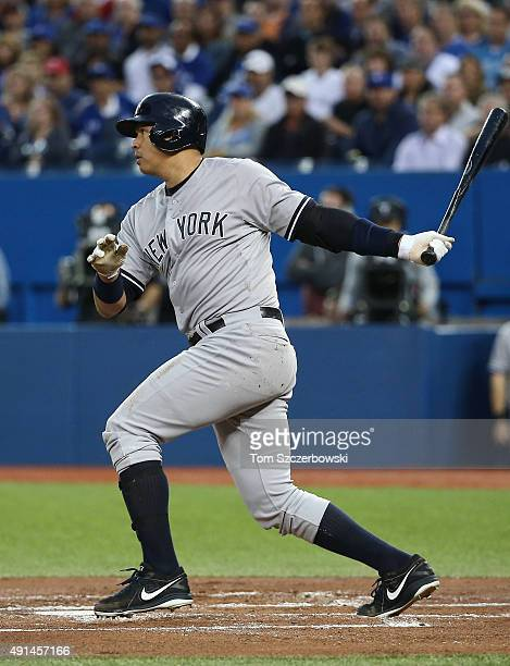 Alex Rodriguez of the New York Yankees hits a single in the first inning during MLB game action against the Toronto Blue Jays on September 21 2015 at...