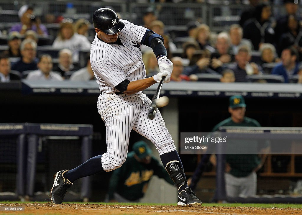 Alex Rodriguez #13 of the New York Yankees hits a single in the fourth inning against the Oakland Athletics at Yankee Stadium on September 21, 2012 in the Bronx borough of New York City.