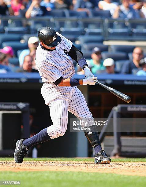 Alex Rodriguez of the New York Yankees hits a solo home run against the Baltimore Orioles in the fifth inning at Yankee Stadium on September 7 2015...