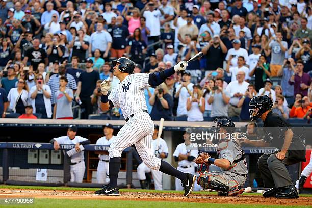 Alex Rodriguez of the New York Yankees hits a solo home run in the first inning for his 3000th career hit against the Detroit Tigers at Yankee...