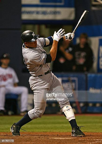 Alex Rodriguez of the New York Yankees hits a solo home run in the 7th inning against the Minnesota Twins in Game Three of the ALDS during the 2009...