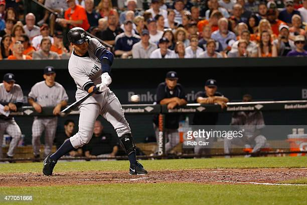 Alex Rodriguez of the New York Yankees hits a two RBI home run in the sixth inning against the Baltimore Orioles at Oriole Park at Camden Yards on...