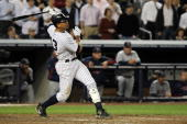 Alex Rodriguez of the New York Yankees hits a two run home run in the ninth inning against the Minnesota Twins in Game Two of the ALDS during the...