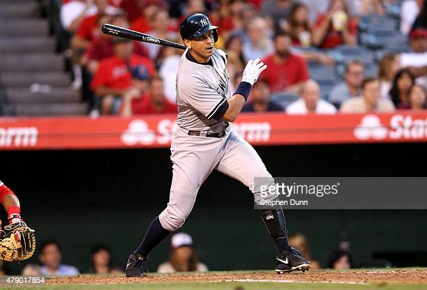 Alex Rodriguez of the New York Yankees hits an RBi single in the third inning against the Los Angeles Angels of Anaheim at Angel Stadium of Anaheim...