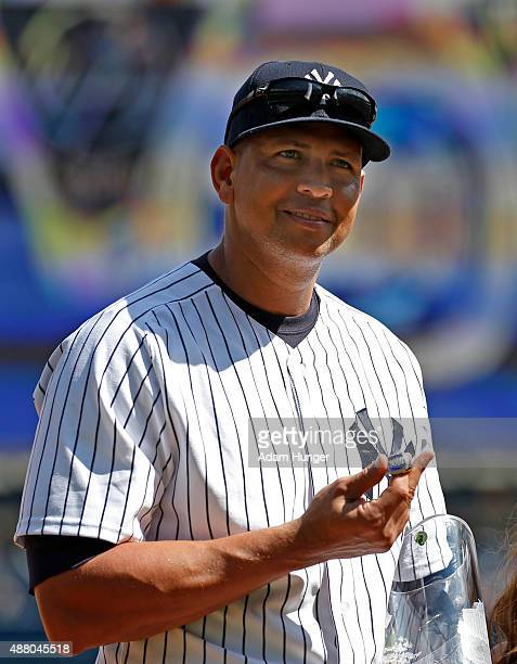 Alex Rodriguez of the New York Yankees holds gifts during a pregame ceremony celebrating Rodriguez's 3000th career hit prior to taking on the Toronto...