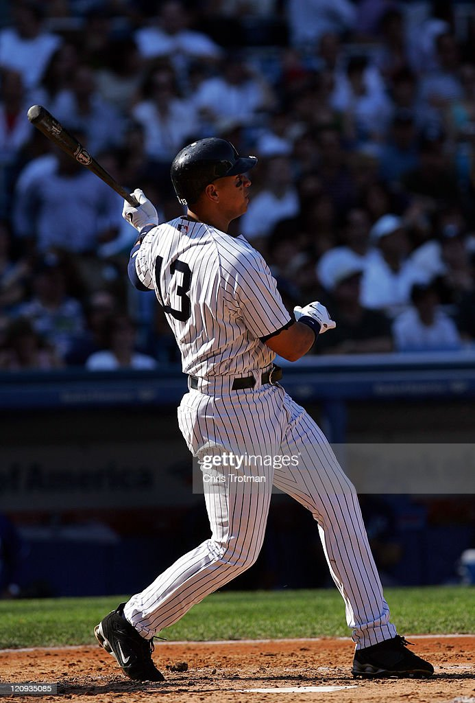 Alex Rodriguez of the New York Yankees homers on a fly ball to left field in the 3rd inning to score teammate Jason Giambi against the Kansas City...