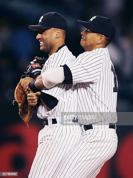 Alex Rodriguez of the New York Yankees hugs Derek Jeter after defeating the Seattle Mariners on May 9 2005 at Yankee Stadium in the Bronx borough of...