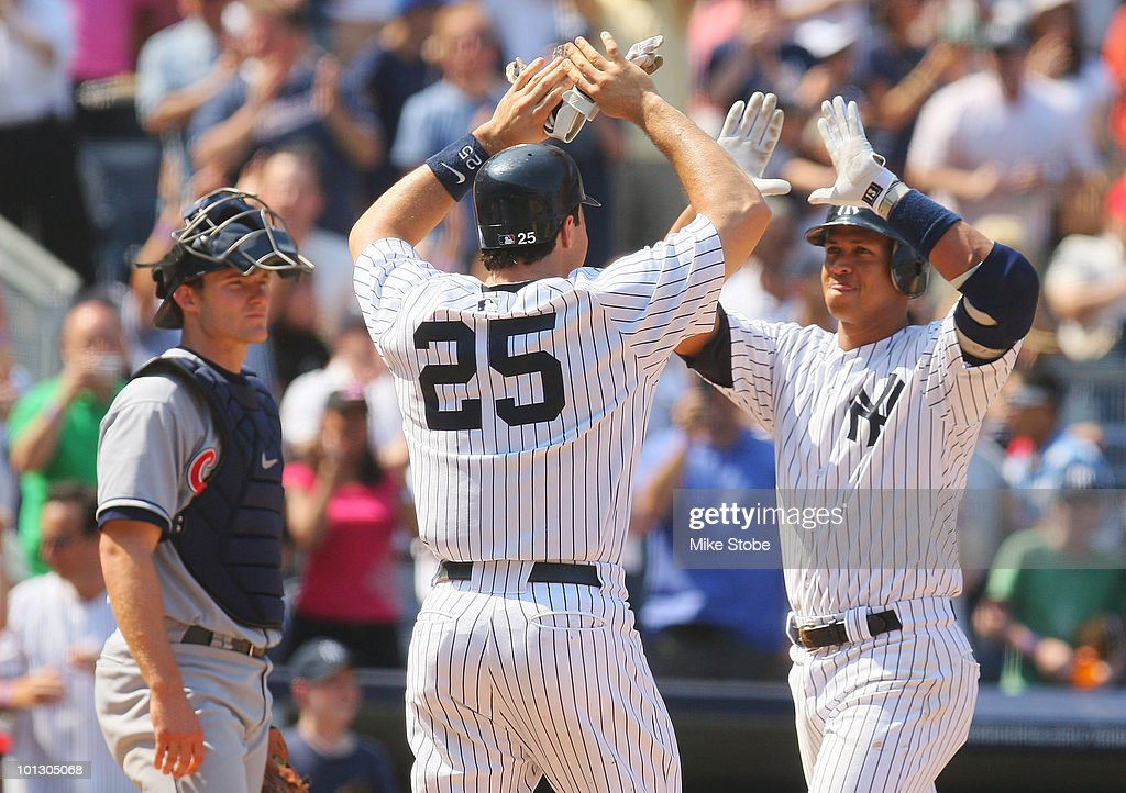 Alex Rodriguez of the New York Yankees is congradulated by Mark Teixeira after hitting a grand slam in the bottom of the seventh against the...