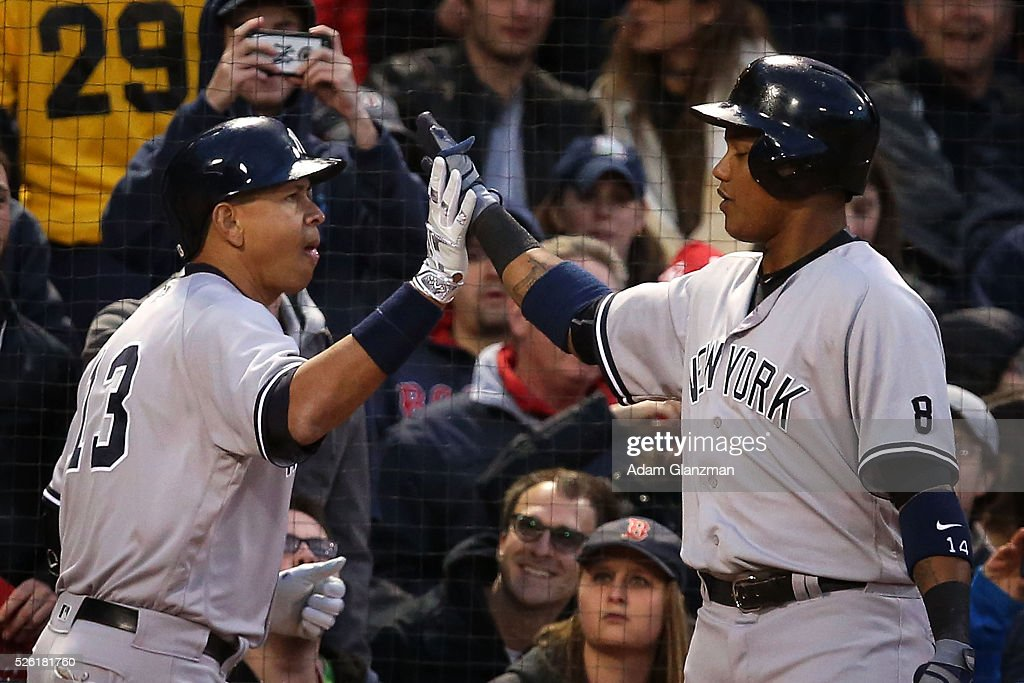 Alex Rodriguez #13 of the New York Yankees is congratulated by <a gi-track='captionPersonalityLinkClicked' href=/galleries/search?phrase=Starlin+Castro&family=editorial&specificpeople=5970945 ng-click='$event.stopPropagation()'>Starlin Castro</a> #14 after hitting a home run in the second inning during the game against the Boston Red Sox at Fenway Park on April 29, 2016 in Boston, Massachusetts.