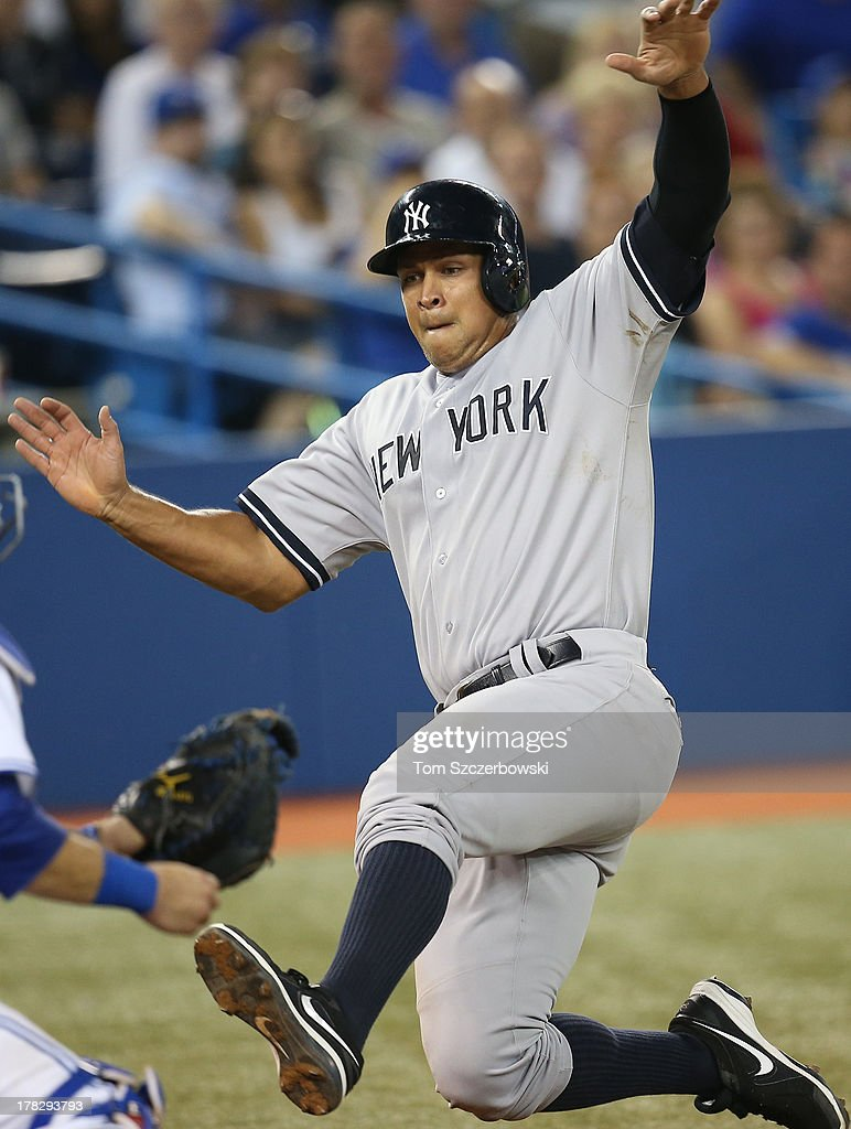 Alex Rodriguez #13 of the New York Yankees is thrown out at home plate in the fourth inning during MLB game action against the Toronto Blue Jays on August 28, 2013 at Rogers Centre in Toronto, Ontario, Canada.