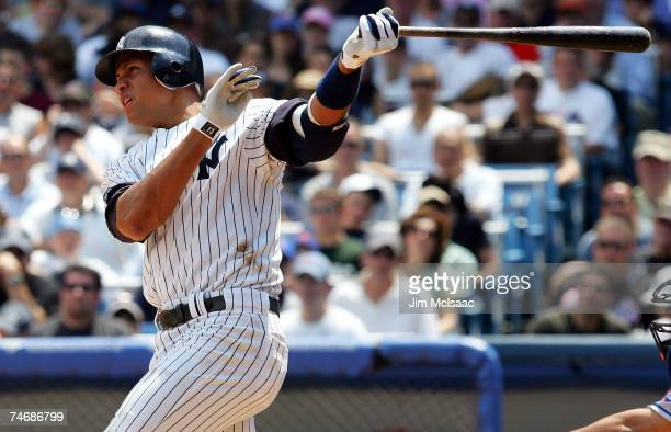 Alex Rodriguez of the New York Yankees launches a two run third inning home run against the New York Mets on June 16 2007 at Yankee Stadium in the...