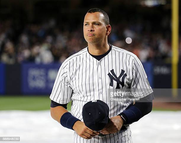 Alex Rodriguez of the New York Yankees looks on after being introduced for a ceremony honoring his retirement from baseball prior to the game against...