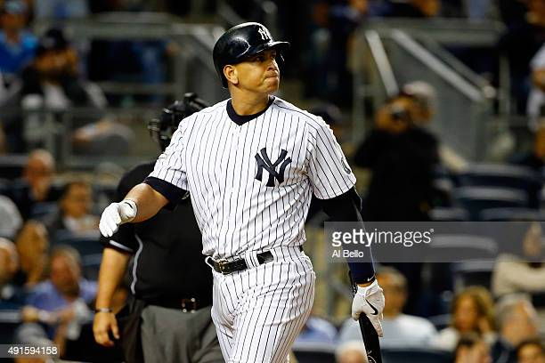 Alex Rodriguez of the New York Yankees looks on after being struck out in the ninth inning against Luke Gregerson of the Houston Astros during the...