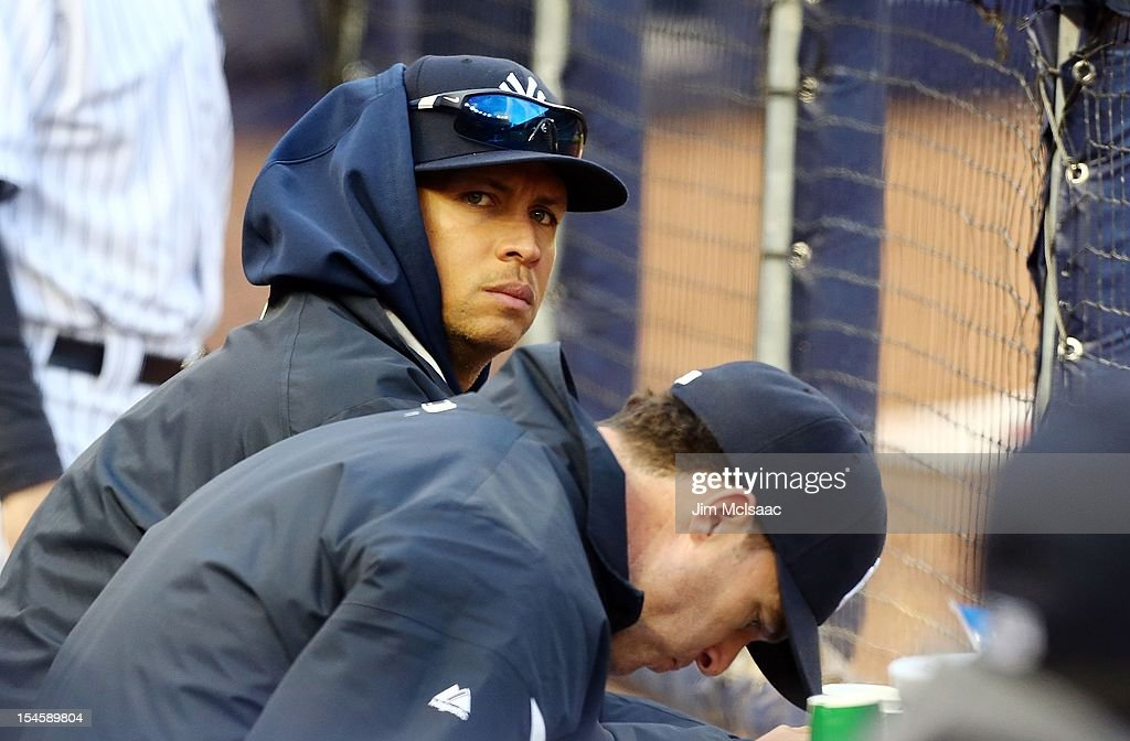 Alex Rodriguez #13 of the New York Yankees looks on from the dugout during Game Five of the American League Division Series against the Baltimore Orioles at Yankee Stadium on October 12, 2012 in the Bronx borough of New York City. The Yankees defeated the Orioles 3-1 to win their best of five series three games to two.