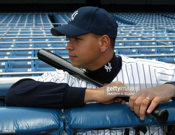 Alex Rodriguez of the New York Yankees poses for pictures while standing in the Yankees dugout following a press conference at Yankee Staduim 17...