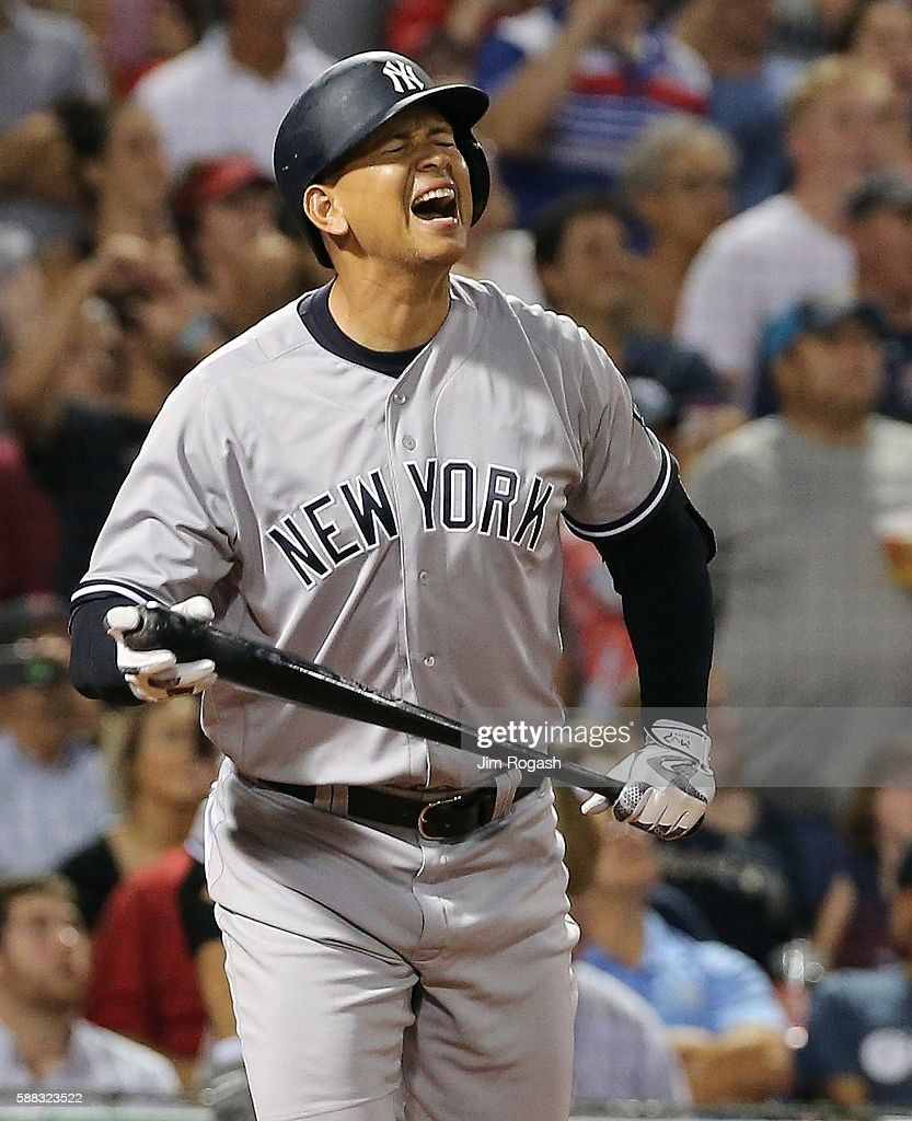 Alex Rodriguez of the New York Yankees reacts after flying out in the seventh inning against the Boston Red Sox with runners in scoring position at...