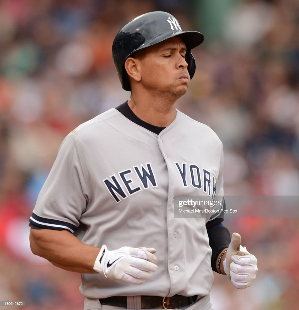 Alex Rodriguez #13 of the New York Yankees reacts after grounding out against the Boston Red Sox in the fifth inning on September 14, 2013 at Fenway Park in Boston Massachusetts.