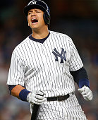 Alex Rodriguez of the New York Yankees reacts after his long fly ball to left field was caught just missing a home run but scoring a run in the fifth...