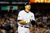 Alex Rodriguez of the New York Yankees reacts after hitting a flied out ball against Dallas Keuchel of the Houston Astros to close out the sixth...