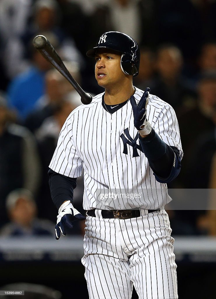 Alex Rodriguez #13 of the New York Yankees reacts after striking out in the sixth inning with runners on base during Game Four of the American League Division Series against the Baltimore Orioles at Yankee Stadium on October 11, 2012 in the Bronx borough of New York City.