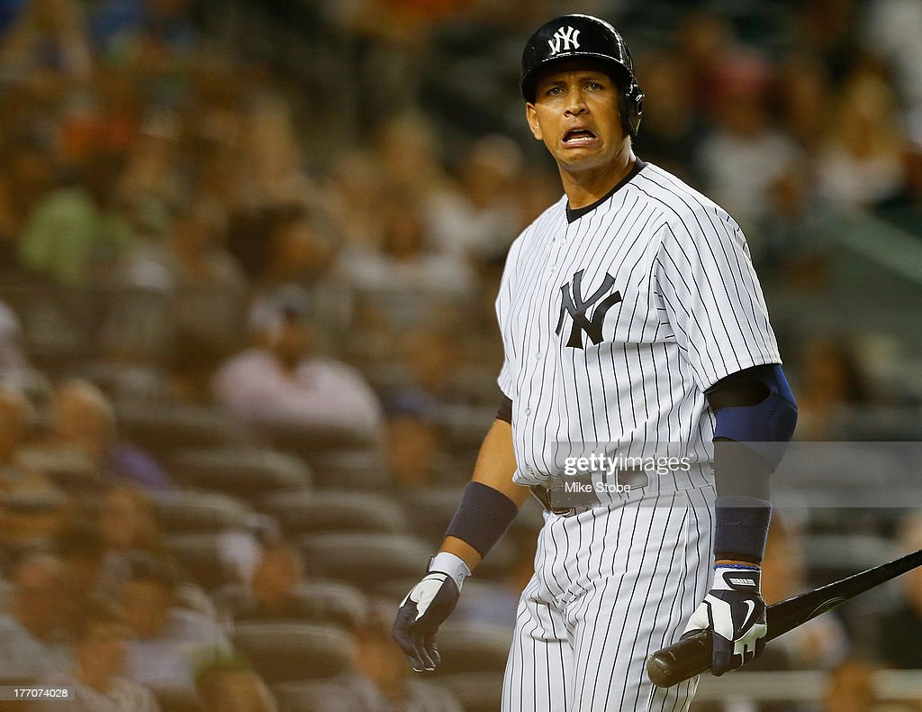 Alex Rodriguez of the New York Yankees reacts after striking out in the fourth inning against the Toronto Blue Jays during the second game of a...