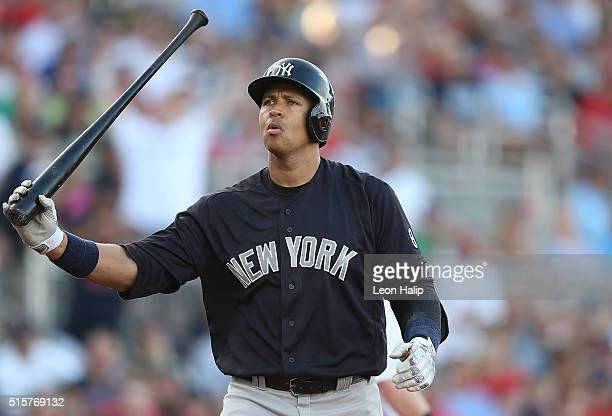 Alex Rodriguez of the New York Yankees reacts after striking out in the first inning of the Spring Training Game against the Boston Red Sox on March...