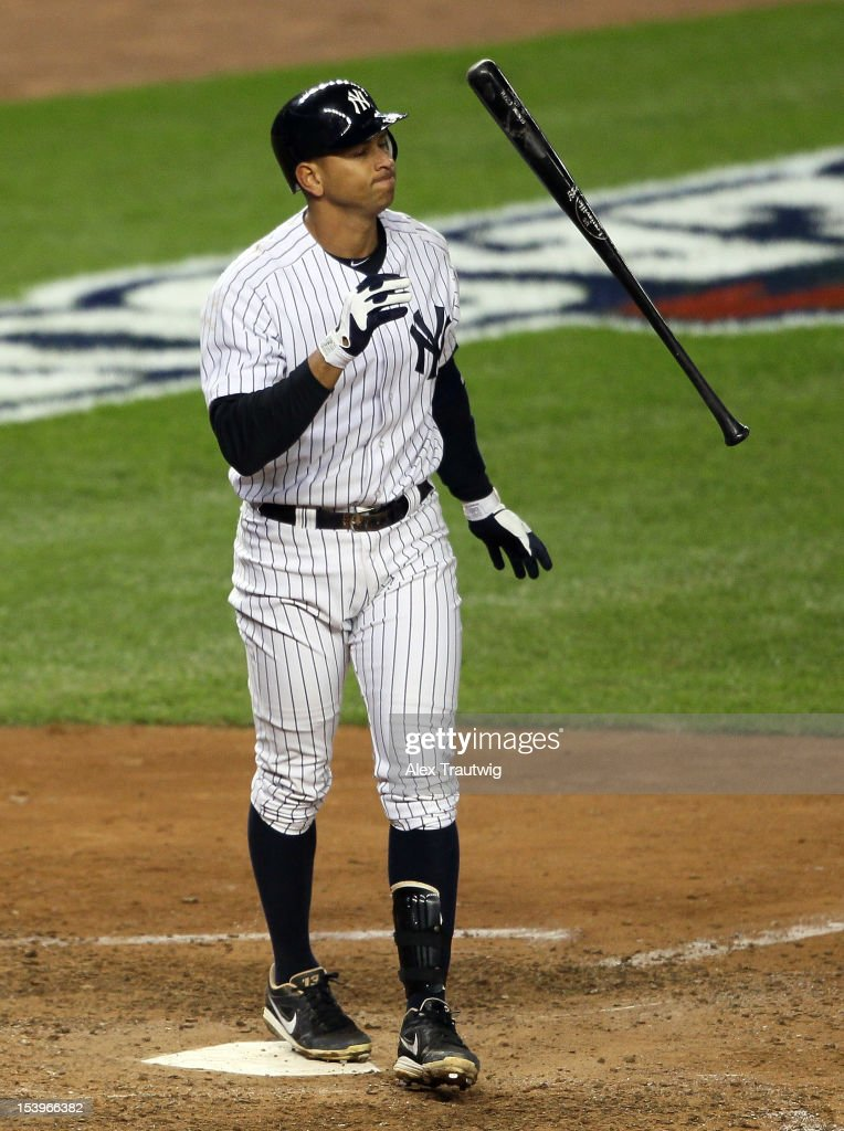Alex Rodriguez #13 of the New York Yankees reacts after striking out during Game Four of the American League Division Series against the Baltimore Orioles at Yankee Stadium on October 11, 2012 in the Bronx borough of New York City.