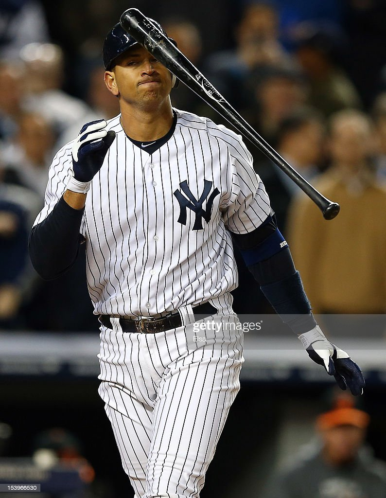 <a gi-track='captionPersonalityLinkClicked' href=/galleries/search?phrase=Alex+Rodriguez+-+Baseball+Player&family=editorial&specificpeople=167080 ng-click='$event.stopPropagation()'>Alex Rodriguez</a> #13 of the New York Yankees reacts after striking out during Game Four of the American League Division Series against the Baltimore Orioles at Yankee Stadium on October 11, 2012 in the Bronx borough of New York City.