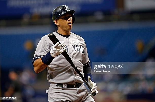 Alex Rodriguez of the New York Yankees reacts after striking out swinging to end the top of the first inning of a game against the Tampa Bay Rays on...