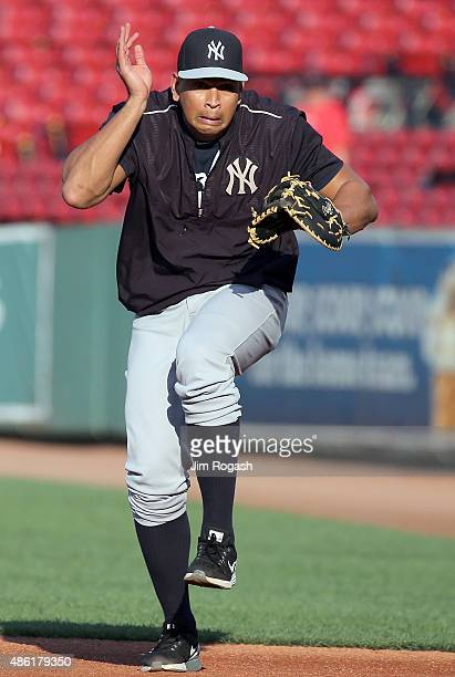 Alex Rodriguez of the New York Yankees reacts as a baseball comes his way as he was talking fielding practice at first base before a game with Boston...