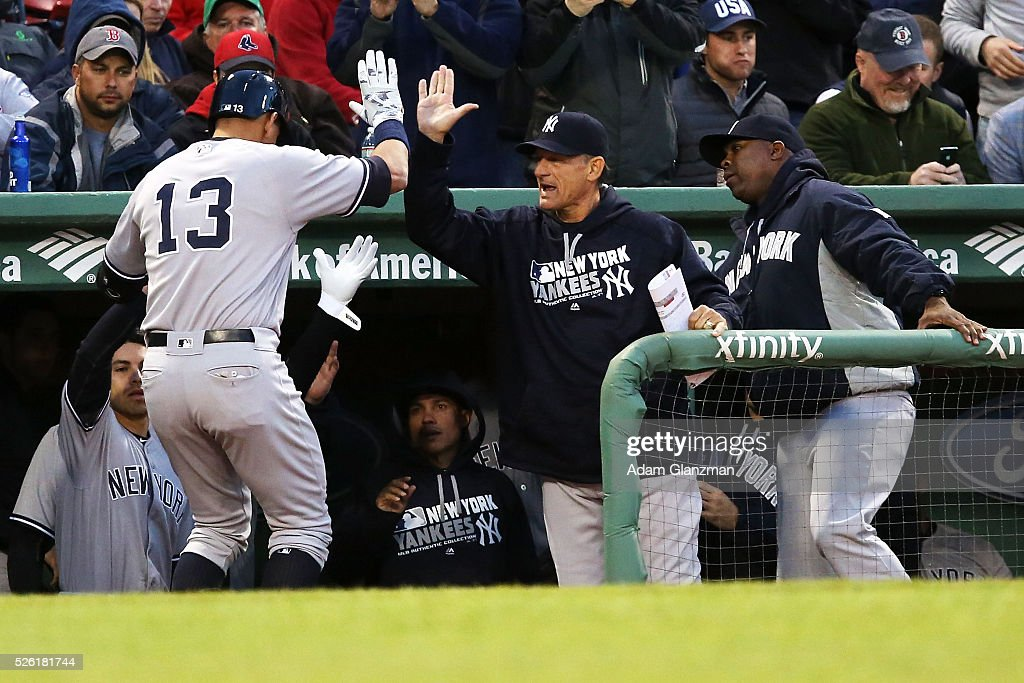 Alex Rodriguez #13 of the New York Yankees returns to the dugout after hitting a home run in the second inning during the game against the Boston Red Sox at Fenway Park on April 29, 2016 in Boston, Massachusetts.